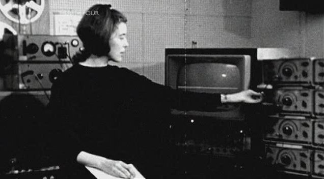 Delia Derbyshire twiddling a knob at the BBC